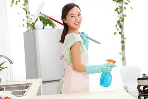 Young woman cleaning in Kitchen