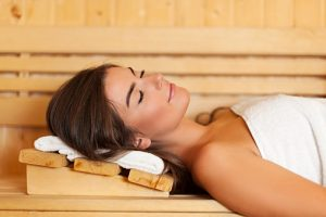 Sleeping woman laying in sauna