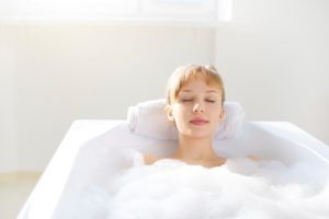 girl relaxing in bathtub