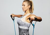 Female athlete using resistance bands